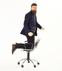 Good looking Business man Flying on a chair