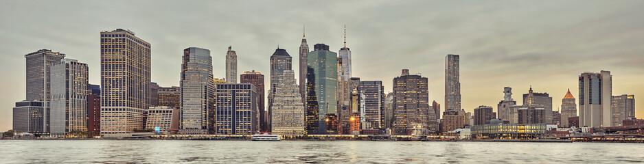 Panoramic picture of the Manhattan skyline at sunset, New York City, USA.