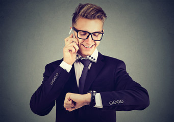 Successful young businessman having call
