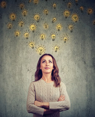 woman contemplating and looking up has many bright ideas