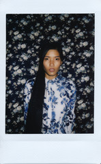 Instant mini film photo of an asian young woman in floral pattern shirt