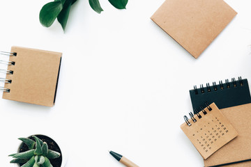 Flat lay minimalistic green and brown styled home office desk workspace .