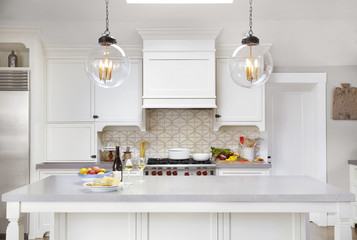Kitchen with food and wine on counter in luxury home