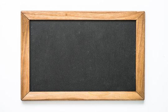 Vintage chalkboard in wooden frame on white background.