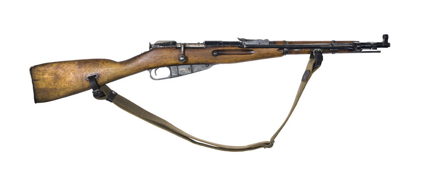 vintage military rifle with bayonet in its closed position, isolated..