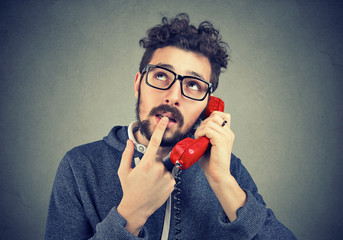 Doubtful man having phone call