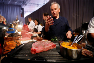 Master Chef Puck cooks a Wagyu steak during a media preview of this year's Academy's Governors Ball in Los Angeles