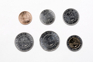 Bolivian coins on a white background