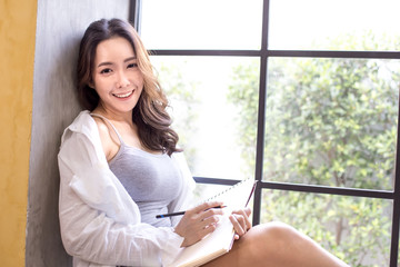 Asian artist woman looking to camera with attractive smiling. People with education concept.
