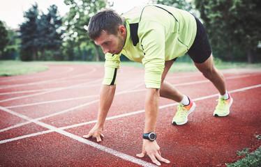 Runner on the start line. Sport, fitness, athletics concept