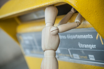 closeup of wooden character in outdoor - concept Postal mail