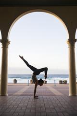 Yoga handstand at Bondi Beach