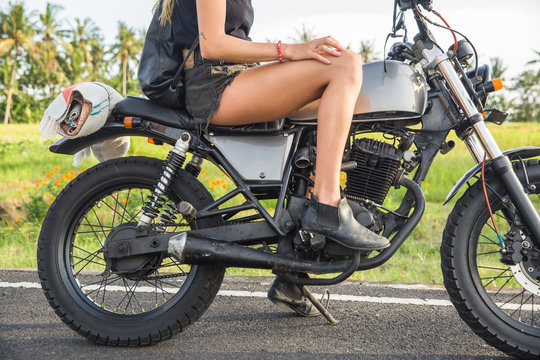 Cute blonde on a motorbike