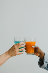 Friends drinking cold pressed juice together - cheers!