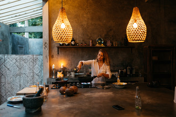 female chef making tacos from scratch cooking in trendy kitchen