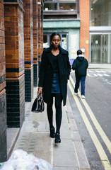 Stylish woman commuting to work