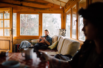 Man sitting in the forest house
