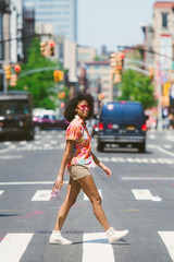 Young woman crossing street in New York City