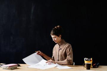 Designer looking over her works