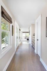 Hallway to bedroom in luxury home
