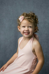 Happy Preschool Girl with Curly Hair Wearing Twirly Pink Dress