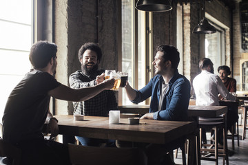 Friends Drinking Beer at Pub
