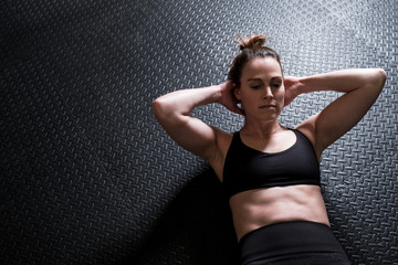 Woman doing sit ups in the home gym