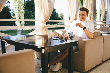 Laughing man in cafe