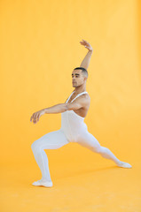 Man in white clothes dancing ballet