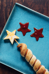 Firewors themed hotdog from overhead