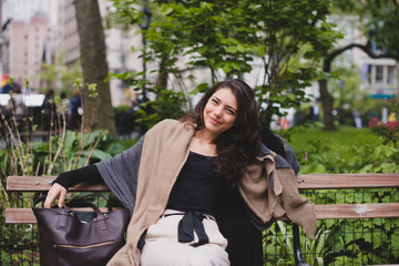 Young professional woman sitting on bench