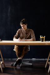Young art teacher in studio