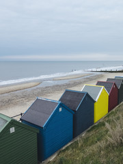 A row of colourful beach huts on the promenade at Mundesley, Nor