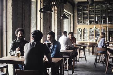Friends Drinking Beer at Bar