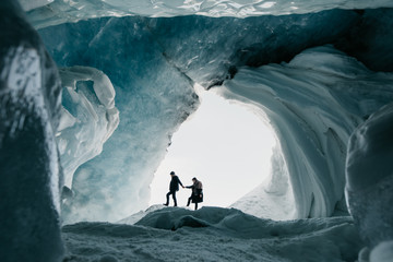 Couple exploring glacier