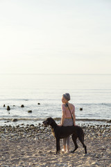 Woman with dog at ocean