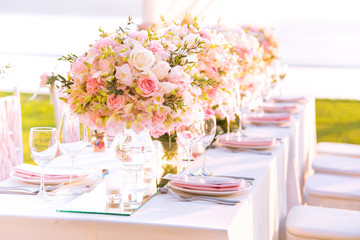 Table setting at a luxury wedding and Beautiful flowers on the table.