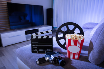Movie Camera With Clapperboard And Popcorn