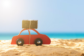 Red Car With Luggage On Sandy Beach