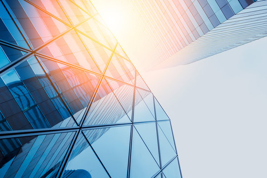 Reflections of modern commercial buildings on glasses with sunlight