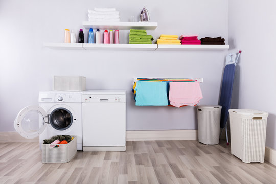 Basket Full Of Dirty Clothes In Laundry Room