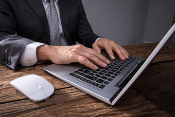 Businessman's Hand Using Laptop