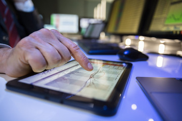 Stock Market Broker Working With Graph On Digital Tablet
