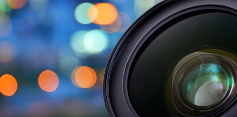 Closeup of camera lens on blur bokeh background