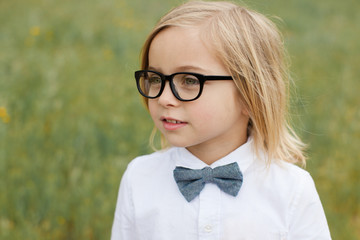 Cute fashionable boy in glasses and bowtie  Fotoväggar