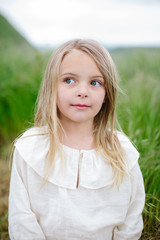 Portrait of a beautiful young girl outside in nature