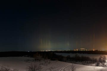 Multicolored radiance in the atmosphere. A natural phenomenon in the night sky over the city.