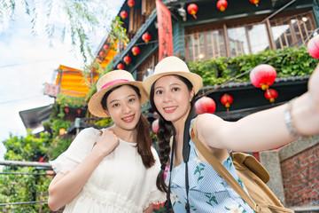Two girls Taking selfie photograph photo