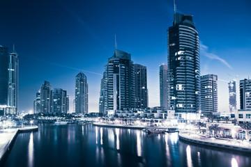 DUBAI, UAE - FEBRUARY 2018: View of modern skyscrapers at night  in Dubai Marina in Dubai, UAE.