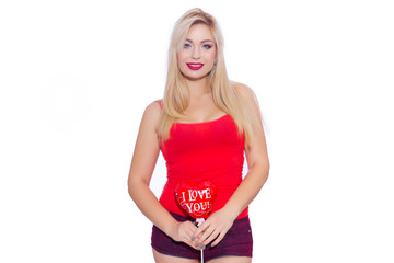 """Portrait of a beautiful sexy blonde woman with a balloon in the shape of a heart. The red ball says """"I love you"""". Isolate"""